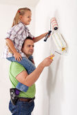 Painting the room with dad — Stock Photo