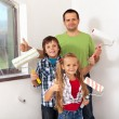 Kids helping there father painting — Stock Photo #42002319