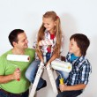 Kids and father with paint rollers and painting ladder — Stock Photo #42002531