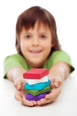 Colorful modelling clay blocks in boy hands — Photo