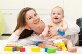 Happy mother and toddler child playing — Stock Photo