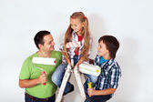 Kids and father with paint rollers and painting ladder — Stock Photo