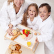 Woman and kids having a light and healthy snack — Stock Photo #43259443