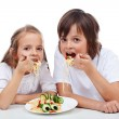 Kids eating a pasta dish — Stock Photo #45241385