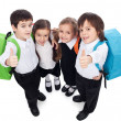 Group of kids giving thumbs up sign - back to school — Stock Photo