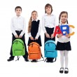 Back to school concept with kids holding schoolbags — Stock fotografie