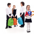 Group of school kids on white background — Stock Photo
