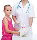 Little girl at the veterinary with her cute white rabbit — ストック写真