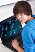 Teenager with laptop — Stock Photo
