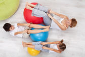 Woman and kids exercising together — Stock Photo