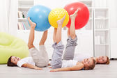 Healthy family exercising at home — Stock Photo