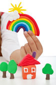 Child hand with modelling clay creations — Stock Photo