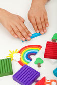 Child hands with modelling clay — Foto Stock