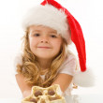 Happy little christmas girl with chocolate — Stock Photo #6409733