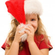 Little girl playing with christmas hat — Stock Photo #6409752