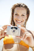 Young woman with camera — Foto Stock