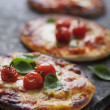 Mini pizzas — Stock Photo #36569071