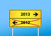 Yellow sign with 2013 direction. — Stock Vector