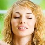 Meditating young woman — Stock Photo