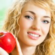 Happy smiling woman with apple — Stock Photo