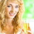 Young woman with glass of champagne - Stock Photo
