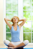Blond woman meditating — Stock Photo