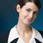 Smiling businesswoman, over blue — Stock Photo
