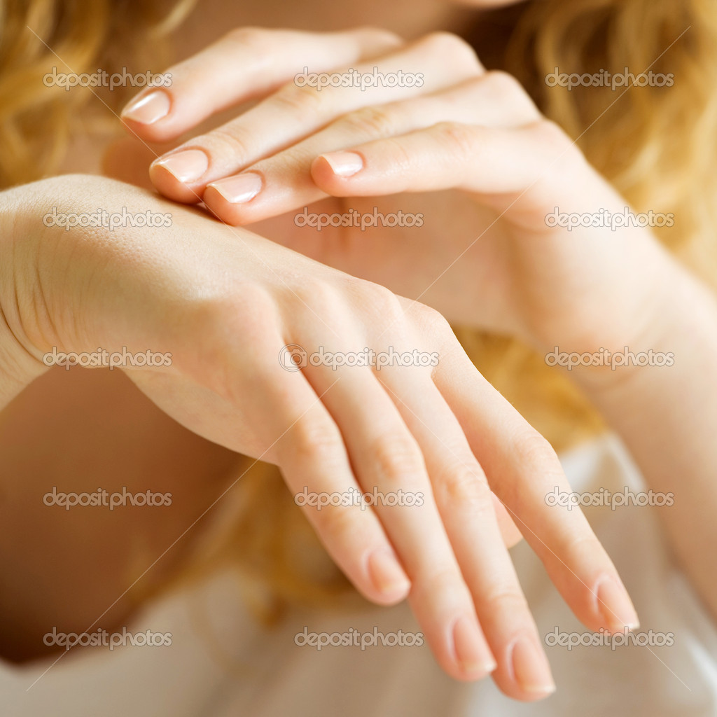 Closeup of woman hands applying cream — Stock Photo #12035728