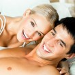 Young embracing cheerful attractive couple — Stock Photo #12156375