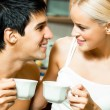 Cheerful couple with cups of coffee, indoor — Stock Photo #12156382