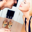 Couple with champagne at restaurant — Stock Photo