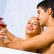 Couple with red wine at bathroom — Stock Photo