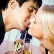 图库照片: Couple kissing at restaurant