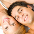 Young embracing cheerful attractive couple — Stock Photo #12156566