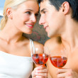 Cheerful couple with glasses of redwine — Stock Photo #12156602