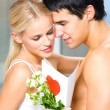 Couple with roses and valentines card - Foto Stock