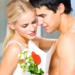 Couple with roses and valentines card - Stock Photo
