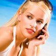 Young woman with cellphone on beach — Stock Photo #12280763