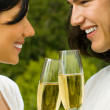 Young happy couple with champagne, outdoor — Stock Photo #12280971
