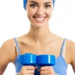 Cheerful woman exercising with dumbbells, over white — Stock Photo #12412222