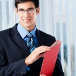 Young businessman with red folder — Stock Photo
