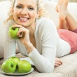 Happy smiling woman with apples — Stock Photo