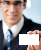 Businessman showing blank business card — Stock Photo