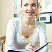 Young woman studying with notebook, indoors — Stock Photo