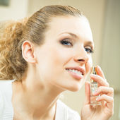 Cheerful woman with perfum bottle — Stock Photo
