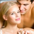 Cheerful smiling young couple, indoors — Stock Photo