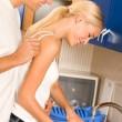 Happy couple washing dishes — Stock Photo