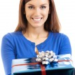 Cheerful woman showing gift, over white — Stockfoto
