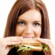 Cheerful woman eating sandwich with cheese — Stock Photo #12578721