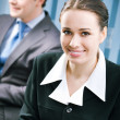 Young smiling businesswoman at office — Stock Photo